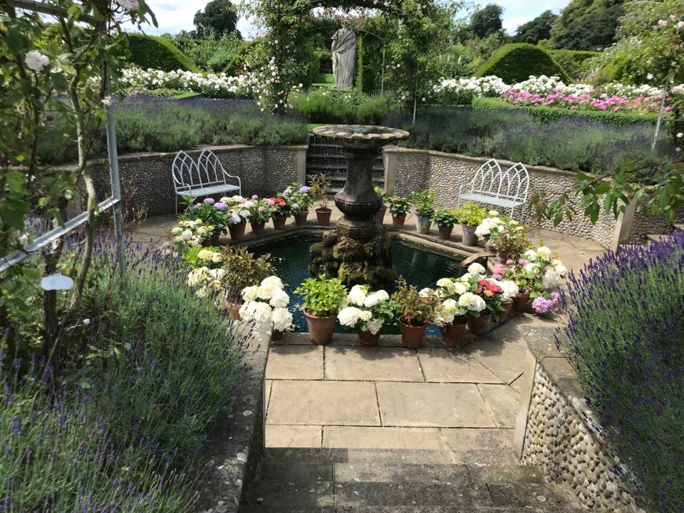 The sunken water feature lined with hydrangeas and relaxing benches