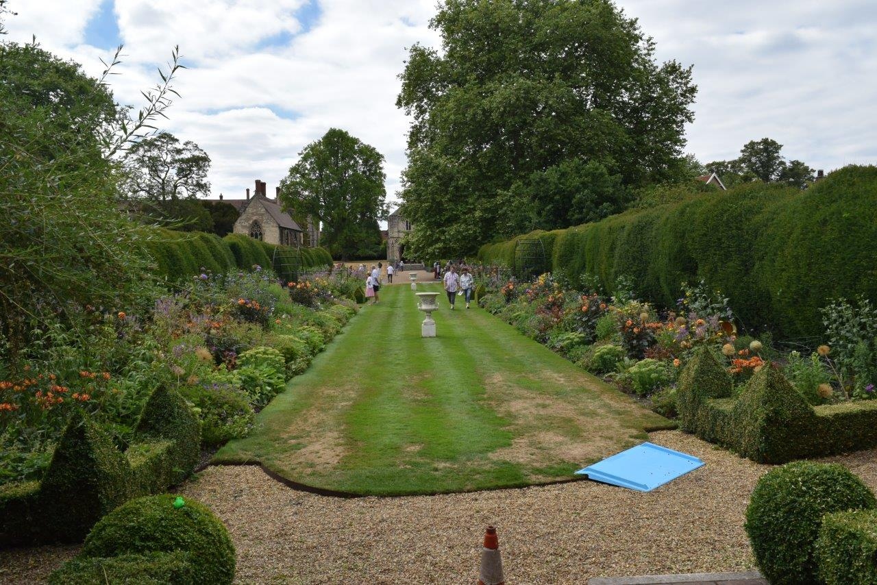 The main lawn and double herbaceous borders in the Bishop's Garden, Norwich