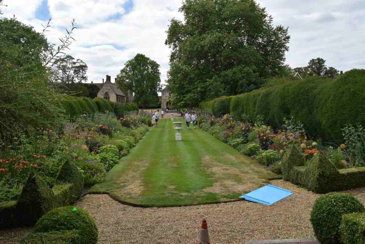 The large lawn flanked with double herbaceous borders