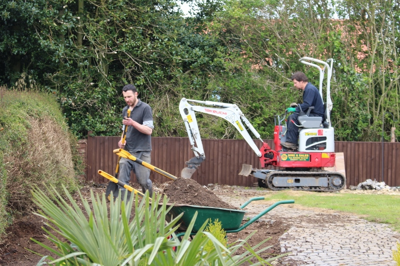 Garden Design and Build in action - Matt and me digging out ground elder
