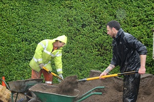 Richard and Matt moving soil in the rain