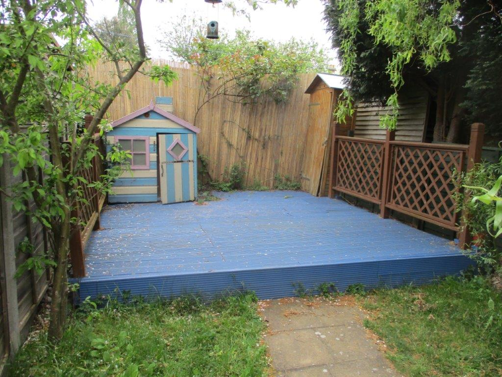 Norwich Garden before Clearance showing Decking and Wendy House