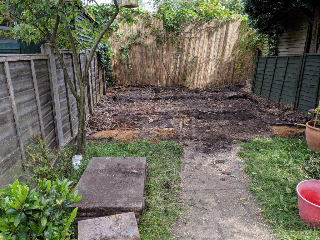 Back garden cleared of decking and wendy house