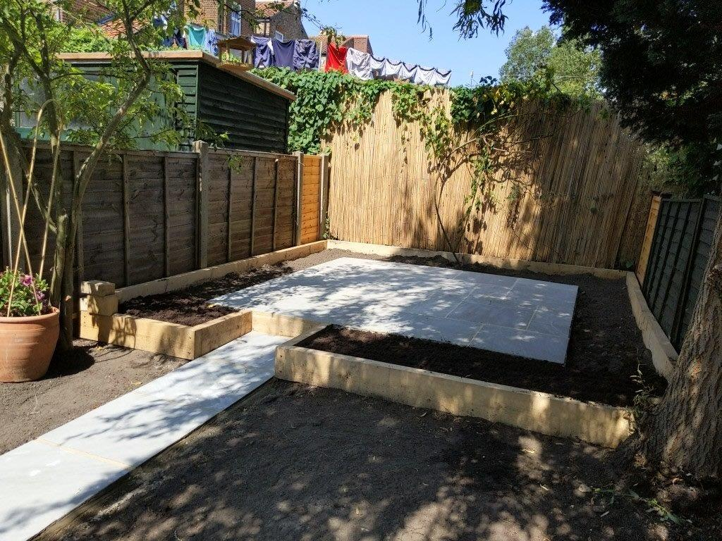 The patio after construction with the raised beds in place and replaced fence panels.